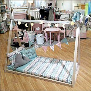 Exposición cama-tienda